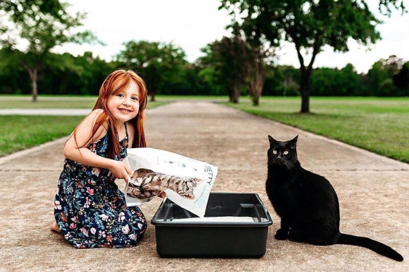 Girl pouring kitty litter