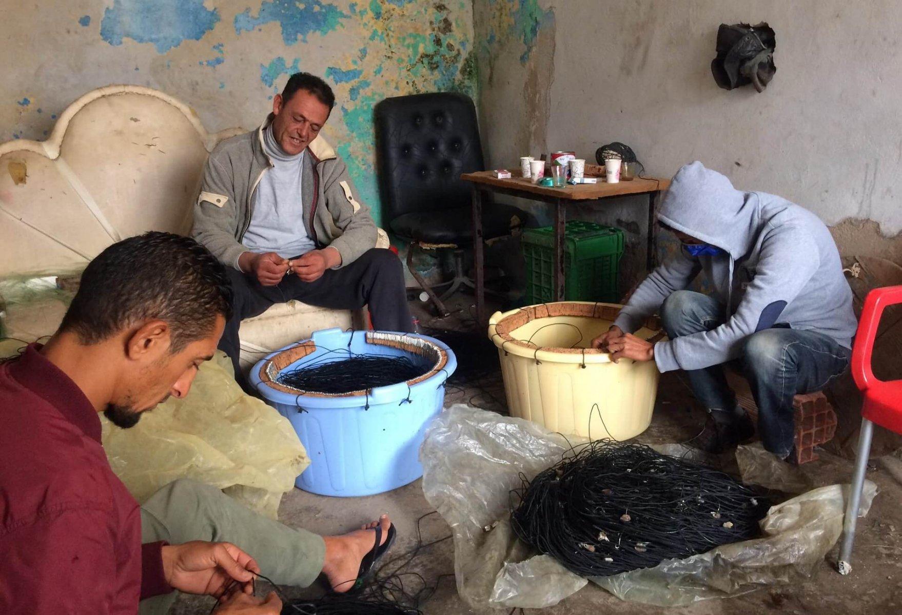 Fishers preparing their new equipment - © Khaled Ben Othman