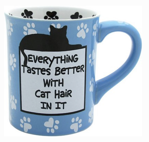 blue mug with cat paw prints and text,