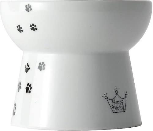 White ceramic elevated cat food bowl with decorative paw prints